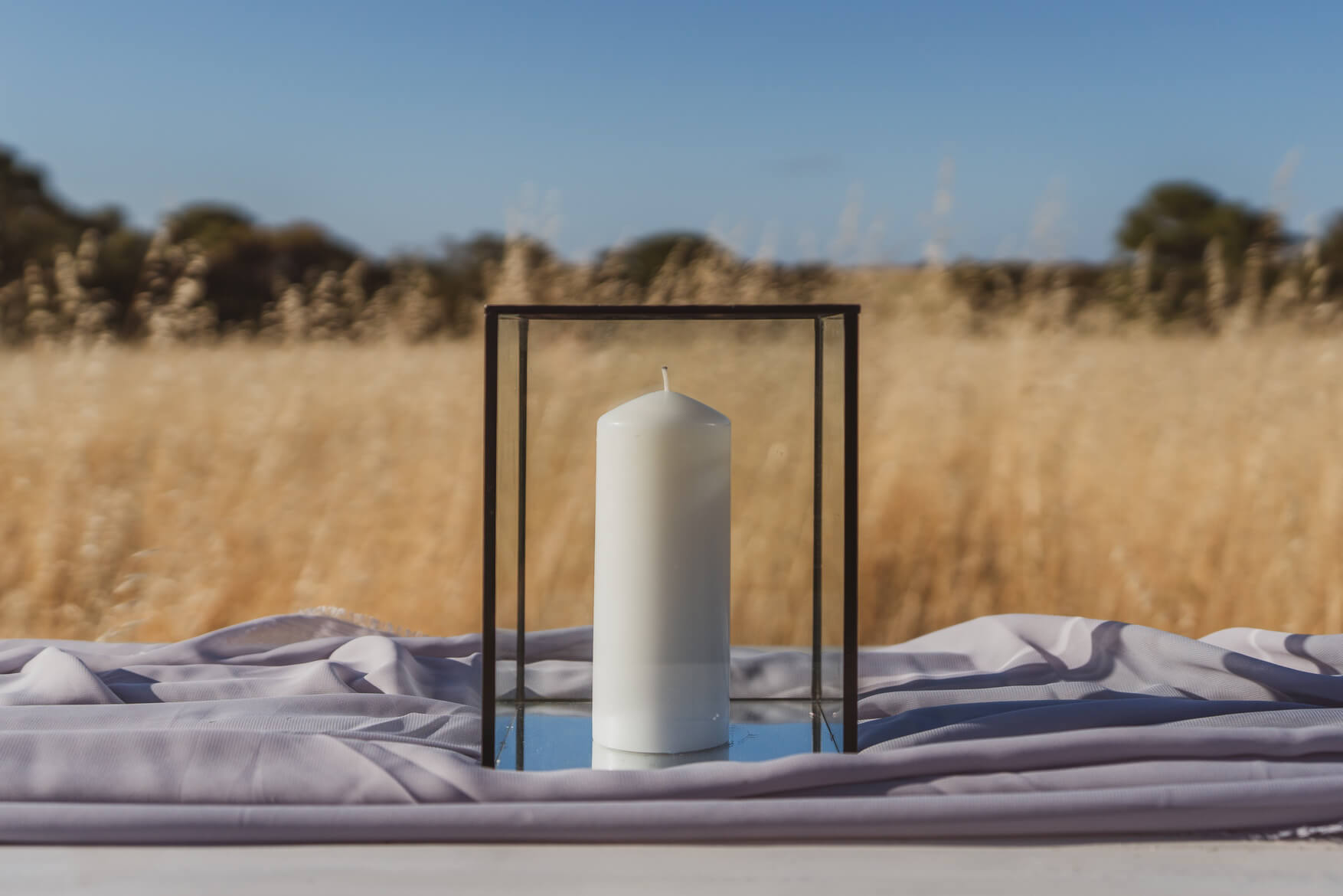 Black rimmed candle holder with pillar candle